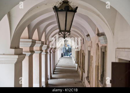ZAMOSC, POLAND - July 26, 2017: Zamosc - Renaissance city in Central Europe. Arcades in old town city centre. - Stock Photo