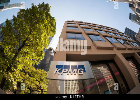 The 'tombstone' outside of 345 Park Avenue in New York announces that it is the NY headquarters of the KPMG accounting - Stock Photo