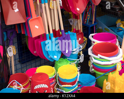 Buckets and spades and other seaside toys on display at seaside shop, Perranporth, Cornwall, England, UK - Stock Photo