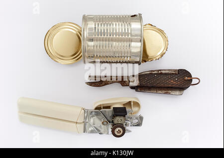 Can Openers - Results of a Can Opened by a WWI /II Forces Issue Knife and a Modern Can Opener - Stock Photo
