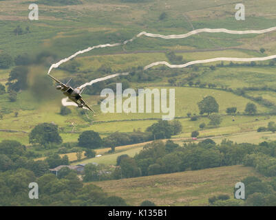 F-15C Eagle aircraft from RAF Lakenheath on a low level training flight in the Mach Loop, LFA7 area of Snowdonia - Stock Photo
