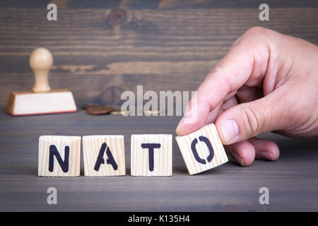 Nato from wooden letters on wooden background - Stock Photo