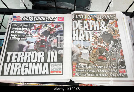 New York tabloid newspapers use the same photograph on Sunday, August 13, 2017 of anti-alt-right protesters in Charlottesville, - Stock Photo