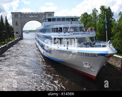 A cruise ship enters a lock on Volga river, north of Moscow - Stock Photo