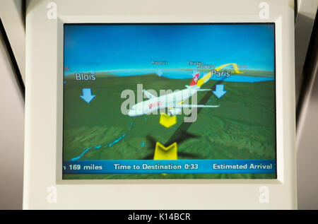 Aeroplane / air plane cabin flight position map display on TV screen showing aircraft postion above / over France. - Stock Photo