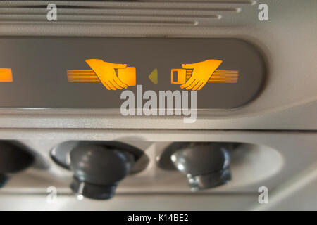 Passenger Fasten Seat belt sign & cool air nozzles / nozzle array / vents / vent console. Airbus A320 aircraft / - Stock Photo