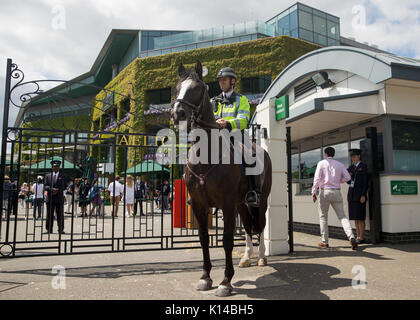 Horse mounted police outside Wimbledon Championships - Stock Photo