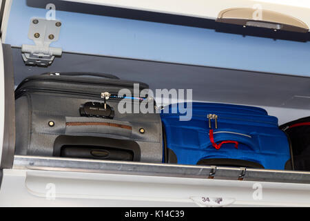 Overhead passenger locker / lockers / compartment / compartments for stowing passengers bags cabin luggage on an - Stock Photo