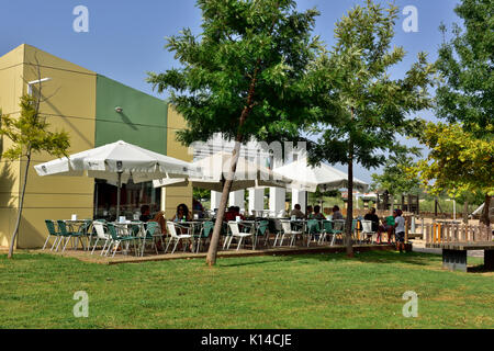 Outdoor cafe next to park, Portugal - Stock Photo