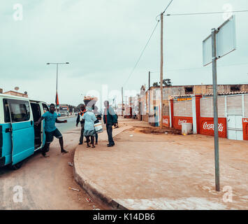 LUANDA, ANGOLA - AUGUST 23, 2017: An Angolan taxi van picks up passengers in Angola's capital of Luanda. - Stock Photo