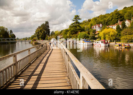 The Thames footpath as it passes over the river on a wooden footbridge at Marsh lock Henley on Thames Oxfordshire - Stock Photo