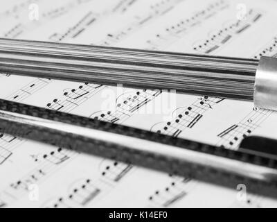 Double bass bow and sheet music - Stock Photo