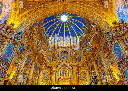 The baroque interior of the San Francisco church featuring gold decorations inside the convent located in the historic - Stock Photo
