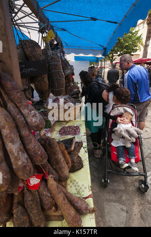 France, Corsica, Ajaccio, market vendors, sausages - Stock Photo