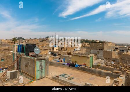 JAISALMER, RAJASTHAN, INDIA - MARCH 07, 2016: Houses view from Saalam Singh Ki Haweli rooftop, carved yellow sandstone - Stock Photo