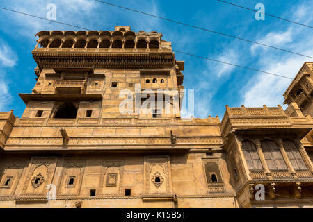 Upward picture of the front of Saalam Singh Ki Haweli, carved yellow sandstone architecture in Jaisalmer, known - Stock Photo