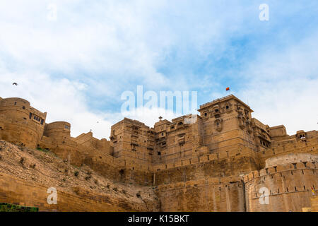 Upward picture of Jaisalmer Fort, carved yellow sandstone architecture in Jaisalmer, known as Golden City in India. - Stock Photo