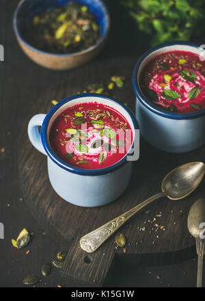 Detox vegan beetroot soup with mint, pistachio and seeds - Stock Photo