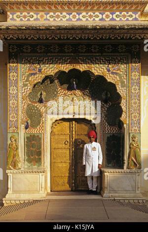 Guard at Peacock Door, Mahajara's City Palace, Jaipur, Rajasthan, India - Stock Photo