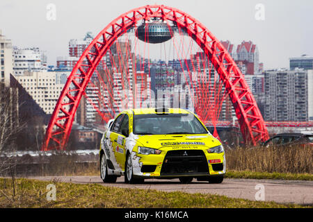 Moscow, Russia - Apr 18, 2015: Mitsubishi Lancer driver Kenavs Marcis and co-driver Gatis Cimdins during the Rally - Stock Photo
