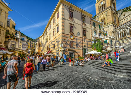 The center of the town of Amalfi on the Amalfi Coast of Italy with the stairs leading up to the famous Amalfi Cathedral - Stock Photo