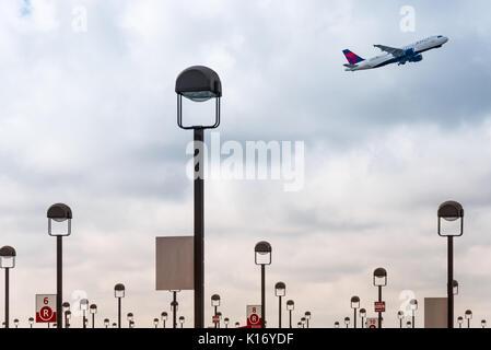Delta Air Lines passenger jet taking off from Hartsfield-Jackson Atlanta International Airport in Atlanta, Georgia. - Stock Photo