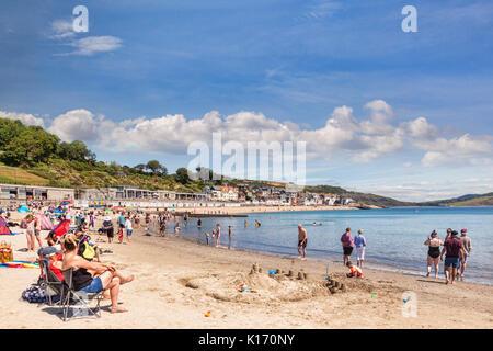 1 July 2017: Lyme Regis, Dorset, England, UK - Sandy Beach on a hot sunny summer day.