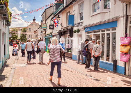 # July 2017: Sidmouth, Dorset, England, UK - People shopping in Old Fore Street on a sunny summer day. Focus on - Stock Photo