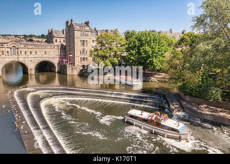 5 July 2017: Bath, Somerset, England, UK - Pleasure Boats at Pulteney Weir on the River Avon. - Stock Photo