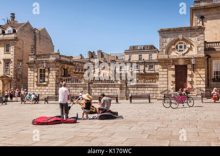 5 July 2017: Bath, Somerset, England, UK - Buskers in Kingston Parade, a small square beside the Roman Baths. - Stock Photo
