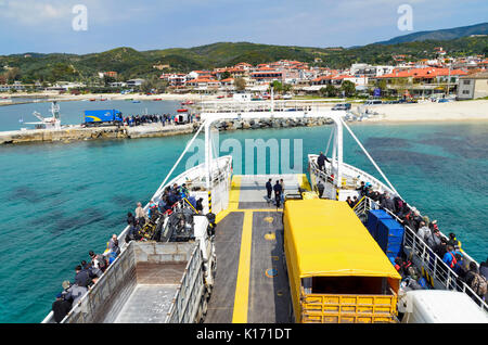 OURANOUPOLI, GREECE - MARCH 31: Tourists descend from ferry in port of Ouranoupoli village on March 31, 2017 in - Stock Photo