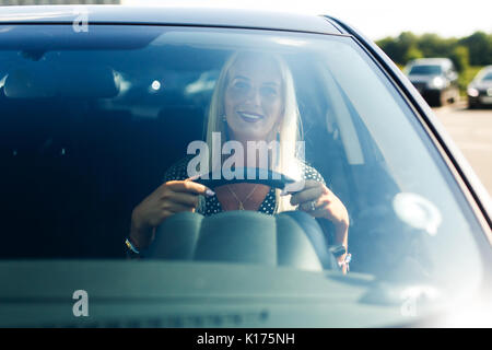 Image of woman driving car - Stock Photo