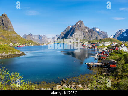 Scenic view across natural fishing harbour to mountains in summer. Reine, Moskenes, Moskenesøya, Lofoten Islands, - Stock Photo