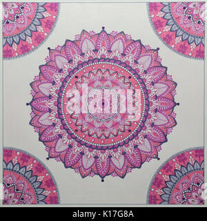 Photo of a sketchbook with a picture of a pink handmade  mandala - Stock Photo