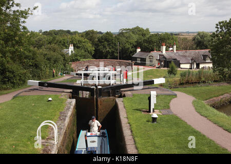 A narrowboat in one of the locks of the Foxton flight on the Grand Union Canal, Leicestershire - Stock Photo