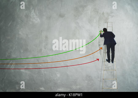 Men drawing three arrow direction on grey wall . - Stock Photo