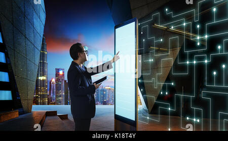 Smart businessman touch the screen to search the information of intelligent communication network of things . Night - Stock Photo