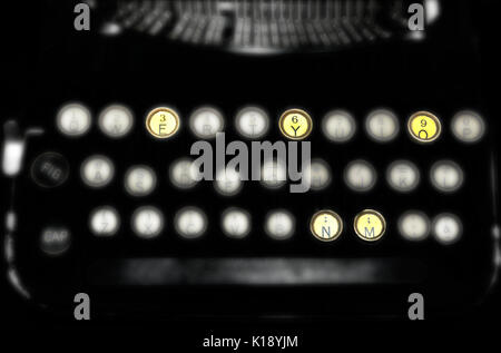A black and white vintage typewriter blurred with four keys with the letters M,O,N,E,Y in focus with their original - Stock Photo
