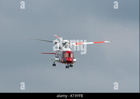 S92A UK Coastguard Sikorsky Helicopter on Execise off the Morayshire coast in Scotland. - Stock Photo