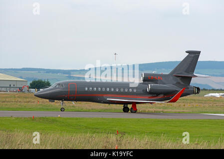 French Built Dassault 3 engined Business luxury jet aircraft at Invernees airport in the Scottish Highlands. - Stock Photo