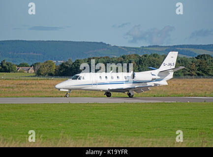 Thin engine Air Charter Cessna 560 arriving at Inverness Dalcross airport - Stock Photo