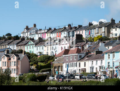 Brightly painted terraced houses in New Quay, Ceredigion, Cardigan Bay, Wales, UK - Stock Photo