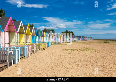 Row of colourful beach huts on Mersea Island, UK - Stock Photo