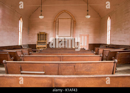 Wooden pews inside rustic Methodist church in Bodie State Historic Park, - Stock Photo