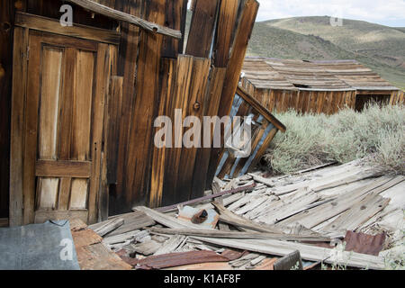 Falling remains of wood structure in Bodie State Historic Park, - Stock Photo
