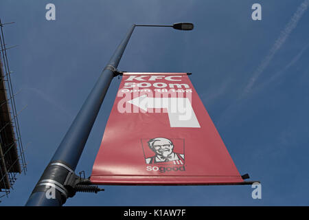 left pointing banner sign for a branch of kfc near heathrow airport, london, england - Stock Photo