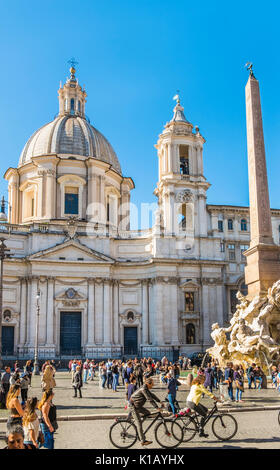 tourists at piazza navonna in front of  the fountain of the four rivers and sant´agnese in agone - Stock Photo