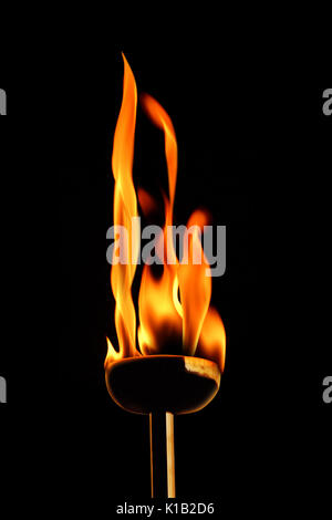 close up shot of burning flaming torch. - Stock Photo