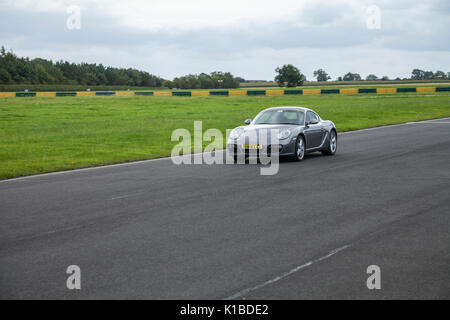 A Porsche Cayman sports car at Croft Motor Racing Circuit,North Yorkshire,England,UK - Stock Photo
