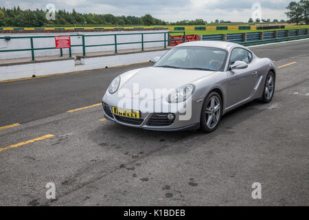 Porsche Cayman car at Croft Motor Racing Circuit,North Yorkshire,England,UK - Stock Photo